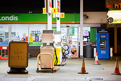 © Licensed to London News Pictures.  01/10/2021. London, UK. A closed petrol station in Peckham, south London, in the early morning. As the eighth day of the fuel crisis continues, amid fears of petrol running out due to a shortage of HGV drivers.  Photo credit: Marcin Nowak/LNP