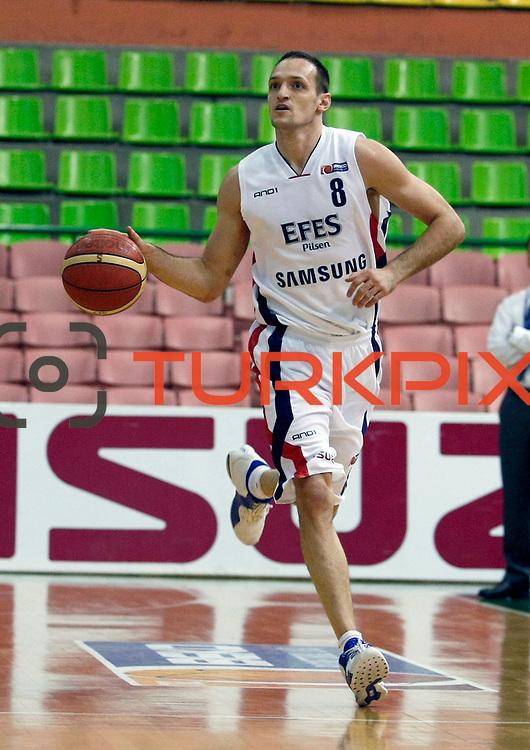 Efes Pilsen's Igor RAKOCEVIC during their Turkish Basketball league match Efes Pilsen between Antalya BSB at the Ayhan Sahenk Arena in Istanbul Turkey on Wednesday 21 April 2010. Photo by Aykut AKICI/TURKPIX