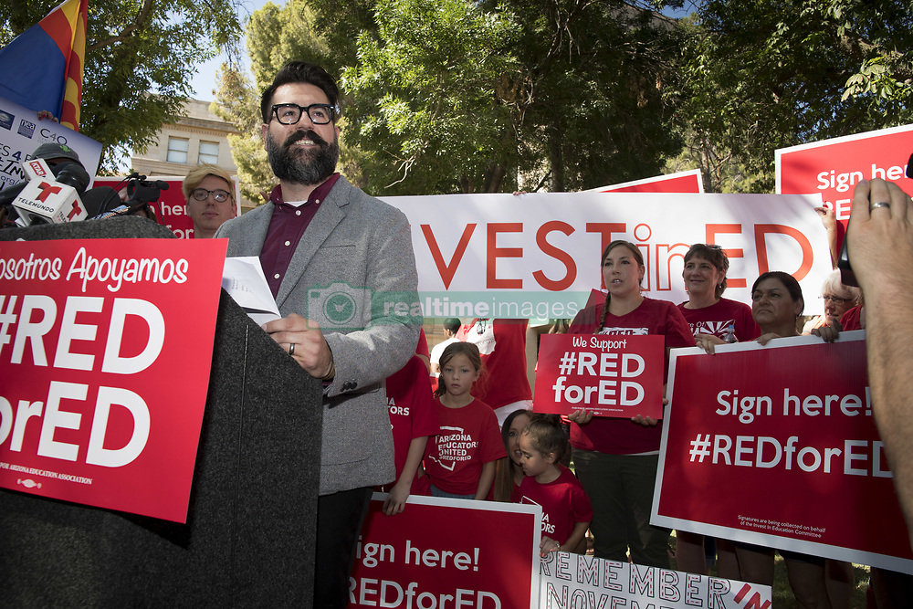 July 5, 2018 - Phoenix, Arizona, U.S - High school government and economics teacher Josh Buckley talks about raising money and fixing the the problems caused by budget shortfalls in the statewide education budget as supporters gather to submit petitions to the state for a ballot measure asking for an income tax on higher wage earners to drastically improve funding. Arizona has ranked 49th in the nation for its education system in recent years, as teachers continue to deal with declining facilities conditions, and have to work two jobs in order to survive. The Red for Ed movement collected more than 270,000 signatures. (Credit Image: ©  via ZUMA Wire)