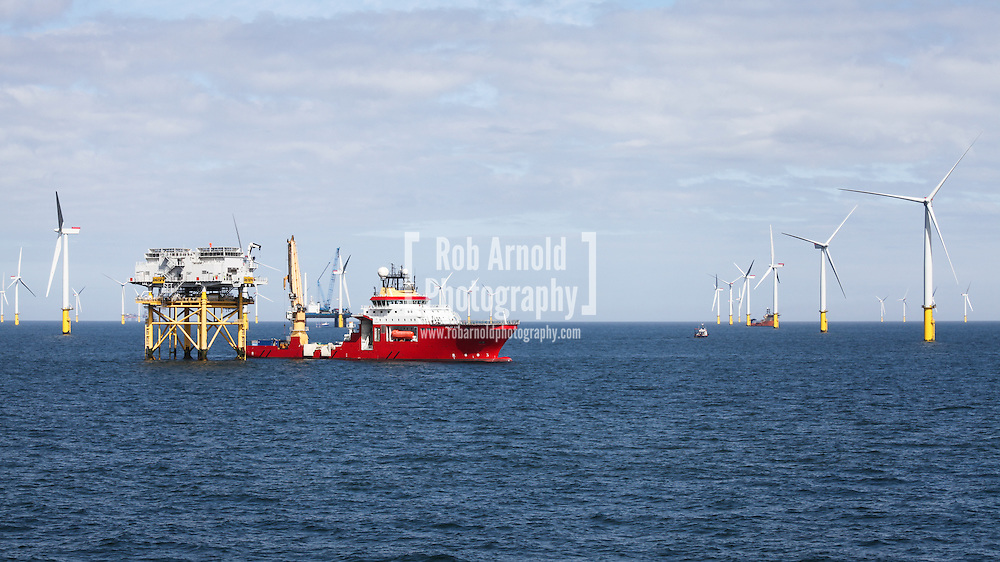 © Rob Arnold.  10/04/2014. North Wales, UK. Reef Subsea construction vessel, Polar King, on the Gwynt y Môr Offshore Wind Farm off the coast of North Wales. Photo credit : Rob Arnold