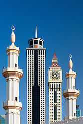 Detail of contrast between mosque minarets and modern skyscrapers in Dubai United Arab Emirate