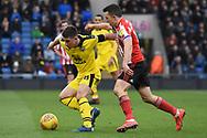 Oxford United midfielder Cameron Brannagan (8) holds off Sunderland midfielder George Honeyman (10) during the EFL Sky Bet League 1 match between Oxford United and Sunderland at the Kassam Stadium, Oxford, England on 9 February 2019.