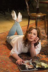 """© Licensed to London News Pictures. 07/04/2014. London, England. Pictured: Holliday Grainger as Irina. The play """"Three Sisters"""" by Anton Chekhov, in a new version by Anya Reiss, opens at the Southwark Playhouse, London, with Paul McGann as Vershinin, Olivia Hallinan as Olga, Emily Taaffe as Masha and Holliday Grainger as Irina. Directed by Russel Bolam. Photo credit: Bettina Strenske/LNP"""