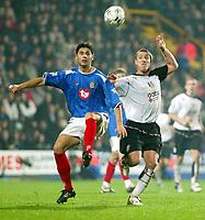 Photograph: Scott Heavey.<br />Fulham v Portsmouth. FA Barclaycard Premiership. 24/11/2003.<br />Dejan Stefanovic clears from Lee Clarke