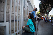 Child participants look Metropolitan Detention Center during Women's March Los Angeles Rally for Families Belong Together on Saturday, June 30th, 2018 at Downtown Los Angeles, California.