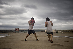 August 31, 2017 - Barcelona, Catalonia, Spain - Raffaele and Stefano practise boxing in the promenade of La Barceloneta in Barcelona. Boxing is becoming a popular sport in Barcelona and many people use to practise it outdoors. (Credit Image: © Jordi Boixareu via ZUMA Wire)