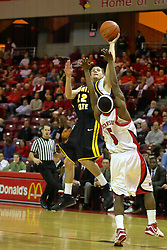"18 January 2007: Matt Braeuer one hands a shot over Keith ""Boo"" Richardson. The Shockers of Wichita State were shut off by the Redbirds by a score of 83-75 at Redbird Arena in Normal Illinois on the campus of Illinois State University."