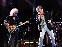 """© Licensed to London News Pictures. 16/09/2012. London, UK.  Brian May (L) and Bruce Dickinson (Right) perform at The Sunflower Jam at the Royal Albert Hall.  Brian May is a founding member and guitarist of Queen, and Bruce Dickinson is a founder member and singer of Iron Maiden.  The Sunflower Jam is a British charity, founded by Jacky Paice, wife of Deep Purple drummer, Ian Paice. Other high-profile supporters are the actor Jeremy Irons, ex-Jamiroquai bassist Nick Fyffe and Charles, Prince of Wales. The aims of the charity are to fund complementary therapists and spiritual healers to work on cancer wards in the British National Health Service. After setting up a meeting between members of Deep Purple and a young boy dying of leukemia, Paice saw """"all the good work the healers were doing"""" and decided """"lets find a way to raise money to get more healers in there. Photo credit : Richard Isaac/LNP"""