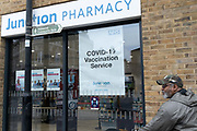 A south Londoner leaves a south London Pharmacy after his pre-arranged Covid-19 vaccinations during the third lockdown of the Coronavirus pandemic, on 2nd March 2021, in London, England. (photo by Richard Baker/In Pictures via Getty Images)