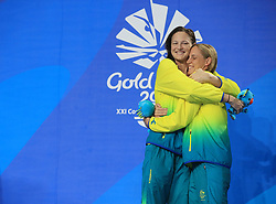 Australia's Bronte Campbell celebrates winning Gold with Australia's Cate Campbell who won Silver in the Women's 100m Freestyle Final at the Gold Coast Aquatic Centre during day five of the 2018 Commonwealth Games in the Gold Coast, Australia. PRESS ASSOCIATION Photo. Picture date: Monday April 9, 2018. See PA story COMMONWEALTH Swimming. Photo credit should read: Mike Egerton/PA Wire. RESTRICTIONS: Editorial use only. No commercial use. No video emulation.