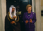 Prime Minister Margaret Thatcher hosts the Emir of Kuwait in London for his first visit, on the steps of Downing Street.