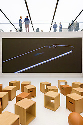 © Licensed to London News Pictures. 13/10/2016. Apple store in Regent Street is unveiled at a press preview with a new exterior and interior design concept by Foster + Partners.  Regent St was the first Apple store in Europe and has served over 60 million customers over the past 12 years. London, UK. Photo credit: Ray Tang/LNP
