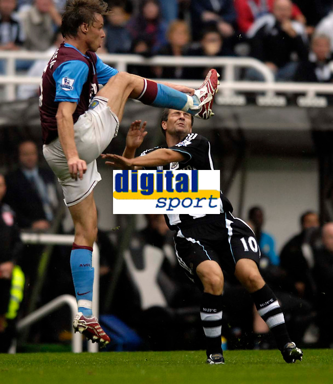 Photo: Jed Wee/Sportsbeat Images.<br /> Newcastle United v Aston Villa. The FA Barclays Premiership. 18/08/2007.<br /> <br /> Newcastle's Michael Owen (R) nearly catches a boot in the face from Aston Villa's Martin Laursen.