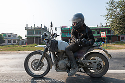 Lowbrow's Mikey Arnold, better known as Mikey Revolt, riding a Royal Enfield Himalayan in Motorcycle Sherpa's Ride to the Heavens motorcycle adventure in the Himalayas of Nepal. Riding from Chitwan to Daman. Tuesday, November 12, 2019. Photography ©2019 Michael Lichter.