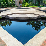 Moongate Garden Smithsonian Castle Gardens Black Granite Pond. The Moongate Garden, behind the Smithsonian Castle, is modeled on the Temple of Heaven, a Ming Dynasty landscape and structure in Beijing.