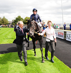 Owner Derrick Smith leads Caravaggio ridden by Seamus Heffernan in to the winners enclosure after winning the Keeneland Phoenix Stakes at Curragh Racecourse, Co. Kildare, Ireland.