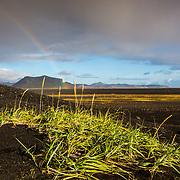 Sólheimasandur arid volcanic scenery and rainbow
