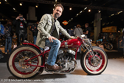 Verner Ortis, a metal worker specializing in stairs and gates for homes in Tolmezzo, Italy, with his custom 1942 Harley-Davidson WLA in the Intermot International Motorcycle Fair. Cologne, Germany. Sunday October 7, 2018. Photography ©2018 Michael Lichter.