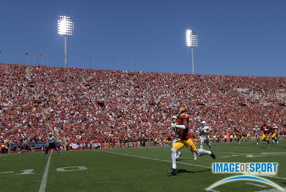 Sep 10, 2016; Los Angeles, CA, USA; USC Trojans defensive back Adoree Jackson (2) scores on a 77-yard punt return in the third quarter against the Utah State Aggies during a NCAA football game at Los Angeles Memorial Coliseum.