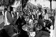 The Grateful Dead – Egypt 1978 . Ken kesey, Bob Weir, Richard Loren and guests at the Sahara City after show dinner.