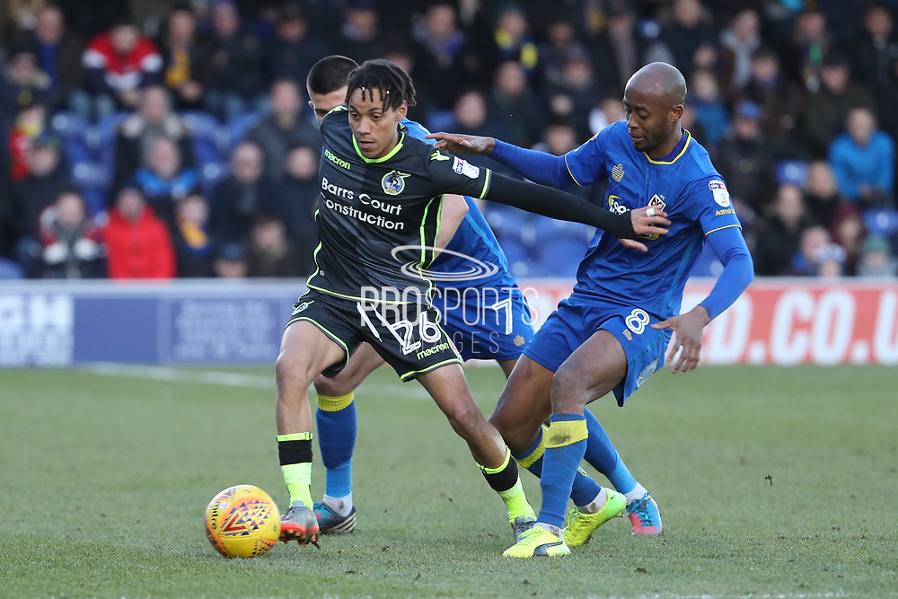 AFC Wimbledon defender George Francomb (7) and AFC Wimbledon midfielder Jimmy Abdou (8) tackling Bristol Rovers midfielder Kyle Bennett (26)  during the EFL Sky Bet League 1 match between AFC Wimbledon and Bristol Rovers at the Cherry Red Records Stadium, Kingston, England on 17 February 2018. Picture by Matthew Redman.
