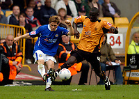 Photo: Richard Lane.<br /> Wolves v Leicester City. Coca Cola Championship.<br /> 17/09/2005.<br /> Leicester's Joey Gudjonsson clears as Wolves' Seyi Olofinjana tackles.