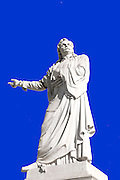 Statue Of Rigas Feraios (1757-1798) at the University of Athens, Athens, Greece on blue background