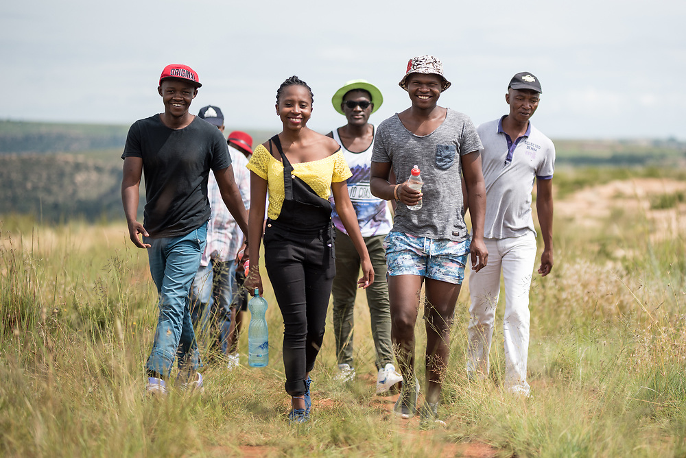 3 March 2017, Thaba Bosiu, Lesotho: A group of young adults from the village of Thaba Bosiu, Lesotho, visit the mountain top. Thaba Bosiu is a sandstone plateau some 24 kilometers east of Lesotho's capital, Maseru. The name means Night Mountain, and surrounding the plateau is a small village and open plains. Thaba Bosiu was once the capital of Lesotho, and the mountain was the stronghold of the Basotho king when the kingdom of Lesotho was formed.