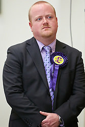 © Licensed to London News Pictures.  16/11/2012. AYLESBURY, UK. Barry Cooper (pictured), UKIP candidate for the Thames Valley region Police and Crime Commissioner, reacts to coming second last in the first preference vote count and being eliminated from the election.  Anthony Stansfeld (not pictured), the Conservative candidate, eventually won the election. Photo credit :  Cliff Hide/LNP
