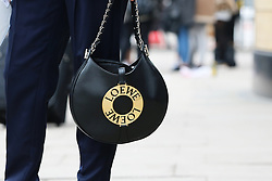 Details of a fashionista's outfit outside the Ryan Lo Autumn / Winter 2017 London Fashion Week show at 180 Strand, London on Saturday February 18, 2017