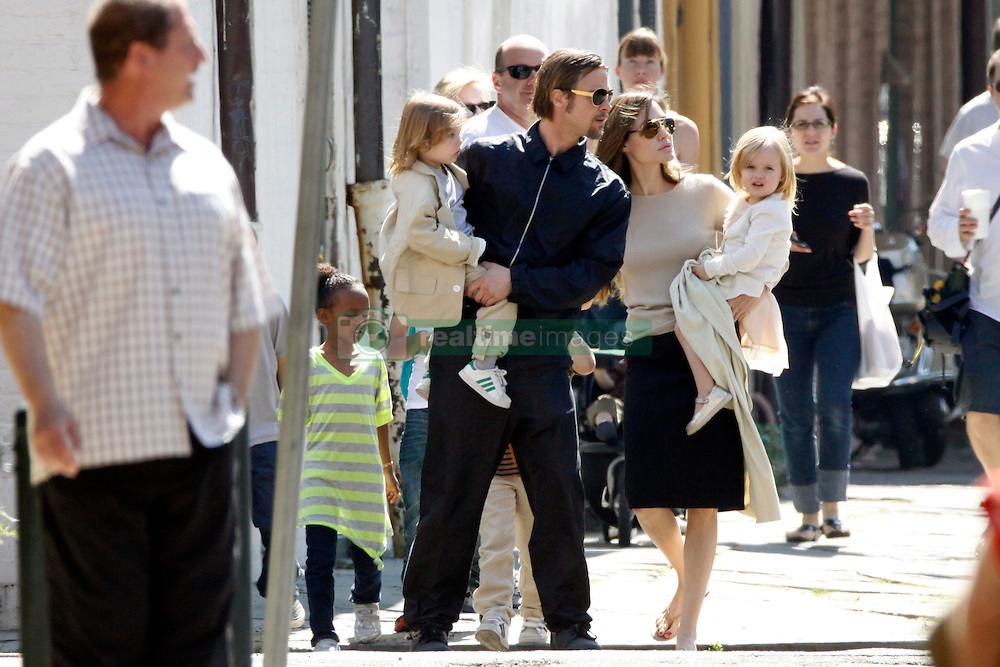 Brad Pitt and Angelina Jolie go for a walk with their six children Maddox, Pax, Zahara, Shiloh, Knox, and Vivienne in their neighborhood in New Orleans, LA, USA on March 20, 2011. Photo by Mehdi Taamallah/ABACAPRESS.COM