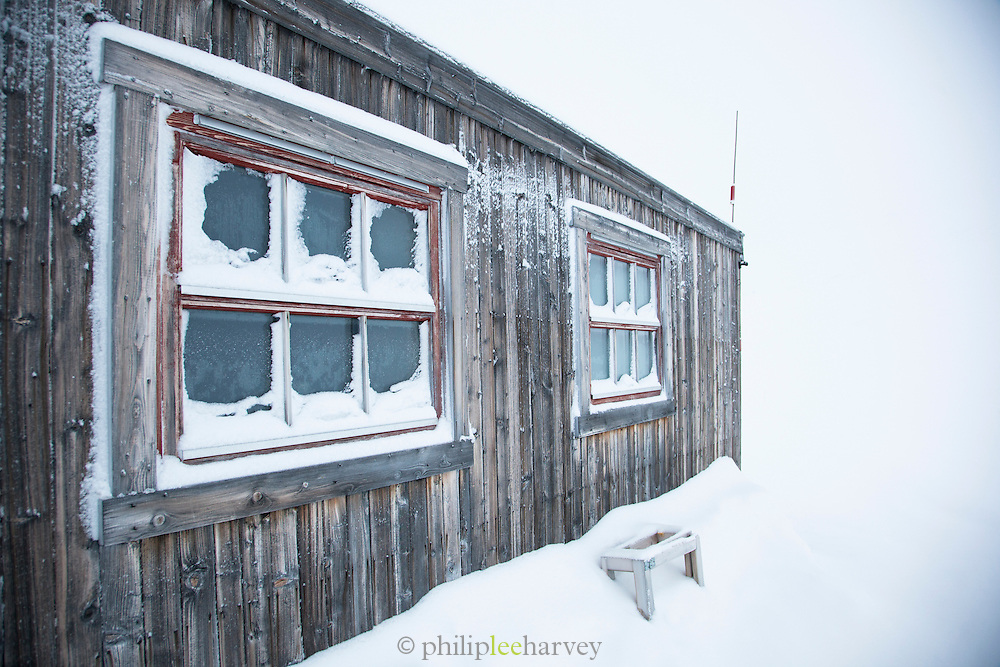 Cabins placed in the wilderness to help people who egt stuck in snow storms or bad conditions, in Spitsbergen. Spitsbergen is the largest island of the arctic archipelago Svalbard, of Norway