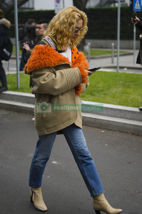 January 15, 2018 - Milan, Italy - Elina Halimi wearing white knit, cropped denim jeans, ankle boots, beige orange jacket, bag is seen outside No21 during Milan Men's Fashion Week Fall/Winter 2018/19 on January 15, 2018 in Milan, Italy. (Credit Image: © Nataliya Petrova/NurPhoto via ZUMA Press)