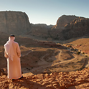 Arab man surveying rocky panorama at Petra, Petra, Jordan (December 2007)