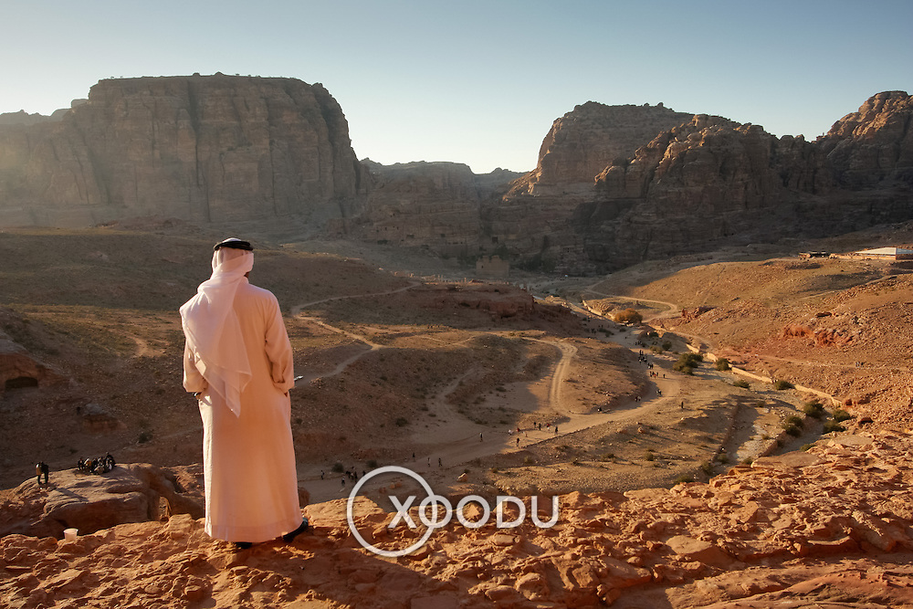 Arab man surveying rocky panorama at Petra, Petra, Jordan (December 2007)