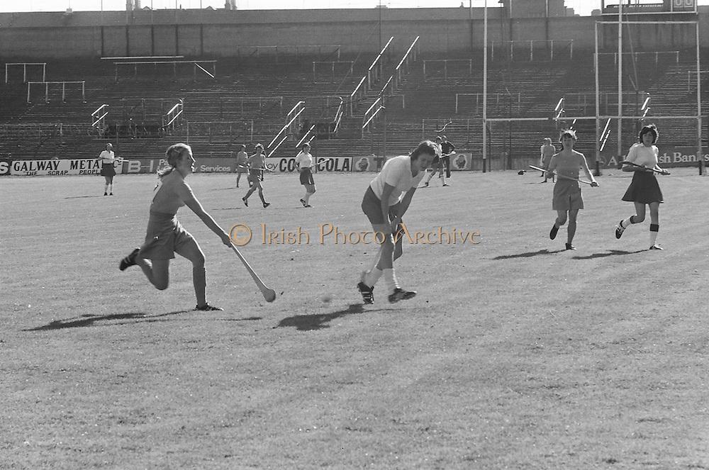 Wexford hits the ball upfield as Cork blocks her during the All Ireland Senior Camogie Final Cork v Wexford in Croke Park on the 21st September 1975. Wexford 4-3 Cork 1-2.