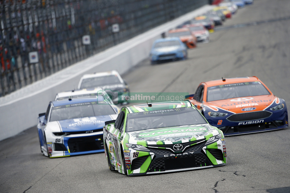 July 22, 2018 - Loudon, New Hampshire, United States of America - Kyle Busch (18) battles for position during the Foxwoods Resort Casino 301 at New Hampshire Motor Speedway in Loudon, New Hampshire. (Credit Image: © Justin R. Noe Asp Inc/ASP via ZUMA Wire)