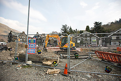 © Licensed to London News Pictures. 11/05/2016. Glenridding UK. Picture taken 10/05/2016 shows diggers still in the centre of Glenridding five months after storm Desmond flooded the village. The diggers are still in the village of Glenridding five months after storm Desmond hit the area & flooded the village three times last December. Residents of the village have become frustrated at the Environment Agency after it took almost four months for the agency to start work on new flood defences leaving the village looking like a building site during the normally busy tourist period essential to get the area back on it's feet. Photo credit: Andrew McCaren/LNP