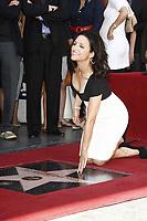 5/4/2010 Julia Louis-Dreyfus posing at her Hollywood Walk of Fame ceremony