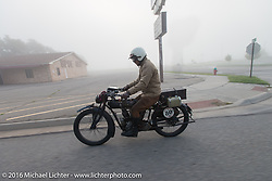 Yoshimasa Nimmi riding the team 80 1915 Indian Twin that he co-rides with Shinya Kimura in the fog at the beginning of Stage 8 of the Motorcycle Cannonball Cross-Country Endurance Run, which on this day ran from Junction City, KS to Burlington, CO., USA. Saturday, September 13, 2014.  Photography ©2014 Michael Lichter.