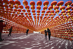 Jan. 29, 2017 - Yinchuan, Ningxia Hui, China - Tourists walk under red lanterns during a week-long Spring Festival holiday in Yinchuan during Year of the Rooster celebrations. (Credit Image: © Xinhua via ZUMA Wire)