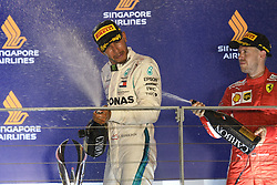 2018?9?16? .??????——F1??????????????..9?16????????????????????????????????2018????F1????????????????????????????????????????????????????????????????? .??????????..Mercedes driver Lewis Hamilton (L) of Britain celebrates with champagne at the trophy ceremony after winning in the the Formula One Singapore Grand Prix Night Race held at the Marina Bay Street Circuit on Sep 16, 2018. Today, Mercedes driver Lewis Hamilton wins the Formula One Singapore Grand Prix Night Race, followed in second place by Red Bull driver Max Verstappen and in third place by Ferrari driver Sebastian Vettel..By Xinhua, Then Chih Wey..????????????2018?9?16? (Credit Image: © Then Chih Wey/Xinhua via ZUMA Wire)