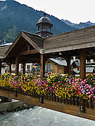 "Flowers bloom in boxes on a footbridge over the River Arve in Chamonix, France, Europe. Published in Ryder-Walker Alpine Adventures ""Inn to Inn Alpine Hiking Adventures"" Catalog 2006."