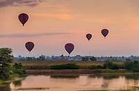 BAGAN, MYANMAR - CIRCA DECEMBER 2013: Hot air balloons flying over the plains of Bagan early morning.