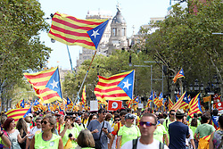 September 11, 2017 - Barcelona, Catalonia, Spain - BARCELONA, SPAIN - SEPTEMBER 11: Hundreds of thousands of people attend a demonstration in Barcelona during the 'Diada',  the National Day of Catalonia, which commemorates the fall of Barcelona in the War of the Spanish Succession in 1714 and the region's subsequent loss of institutions and freedoms. Catalans rally to demand their region's secession from Spain, in a show of strength three weeks ahead of an independence referendum which shall take place on the next October 1st. The referendum was approved by the Catalan Parliament and banned by the Spanish Government. During the demonstration people wave 'Esteladas' (Credit Image: © Manuel Blondeau via ZUMA Wire)
