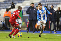 Huddersfield Town's Harry Toffolo threads a pass despite the attentions of Huddersfield Town's Kian Harratt<br /> <br /> Photographer Rich Linley/CameraSport<br /> <br /> The EFL Sky Bet Championship - Saturday 2nd January 2021 - Huddersfield Town v Reading - The John Smith's Stadium - Huddersfield<br /> <br /> World Copyright © 2020 CameraSport. All rights reserved. 43 Linden Ave. Countesthorpe. Leicester. England. LE8 5PG - Tel: +44 (0) 116 277 4147 - admin@camerasport.com - www.camerasport.com