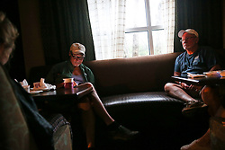 October 7, 2016 - Titusville, Florida, U.S. - WILL VRAGOVIC   |   Times.Nelson Hall, 64, and Glenn Moore, 68, sit by a window in the lobby of the Hampton Inn as Hurricane Matthew rages outside in Titusville, Fla. on Friday, Oct. 7, 2016. (Credit Image: © Will Vragovic/Tampa Bay Times via ZUMA Wire)
