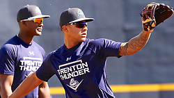 May 2, 2017 - Trenton, New Jersey, U.S - GLEYBER TORRES (right), a top prospect for the Yankees who is a regular shortstop for the Trenton Thunder and occasionally plays second base, is also being given reps and game time at 3rd base to increase his versatility. Here he is this afternoon practicing at third base before tonight's game vs. the Harrisburg Senators, where Torres will man third base for the Thunder. Behind him is MIGUEL ANDUJAR, a regular third baseman for the Thunder. (Credit Image: © Staton Rabin via ZUMA Wire)