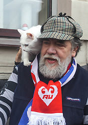 April 24, 2018 - Saint Petersburg, Russia - April 24, 2018. - Russia, Saint Petersburg. - St. Petersburg painter, founder of Mitki movement Dmitry Shagin and Hermitage oracle cat Achilles near the cat cafe 'Cats Republic' during the arts marathon 'My love: football and cat! (Credit Image: © Russian Look via ZUMA Wire)