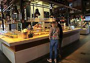 Customers inside Mercado de San Miguel market, Madrid city centre, Spain